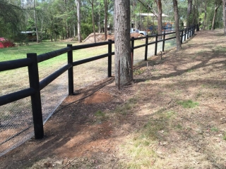 Colonial-post-and-2-rail,-1.5-high-netted-and-painted-black